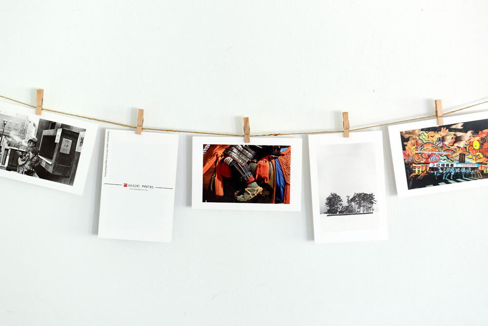 Postards from Akashi Photos hanged on a string