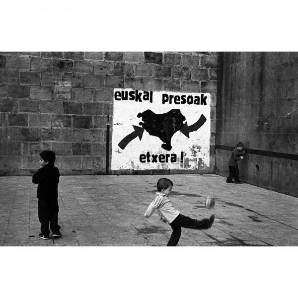 Basque children play in a Basque pelota court. Bizcaya