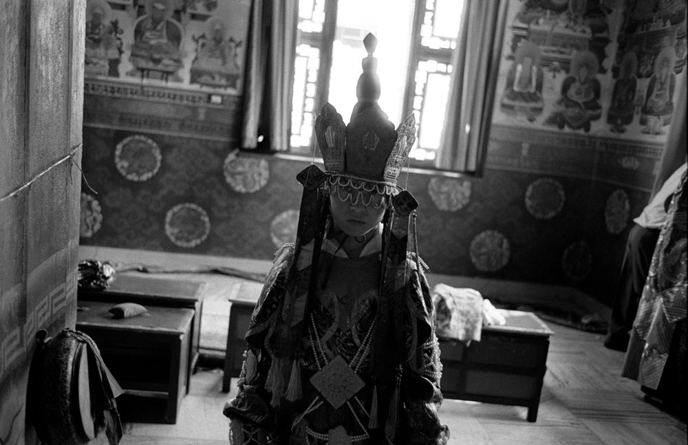 A Tibetan Buddhist monk in a traditonal festival cloth in a monastery in Kathmandu, Nepal.