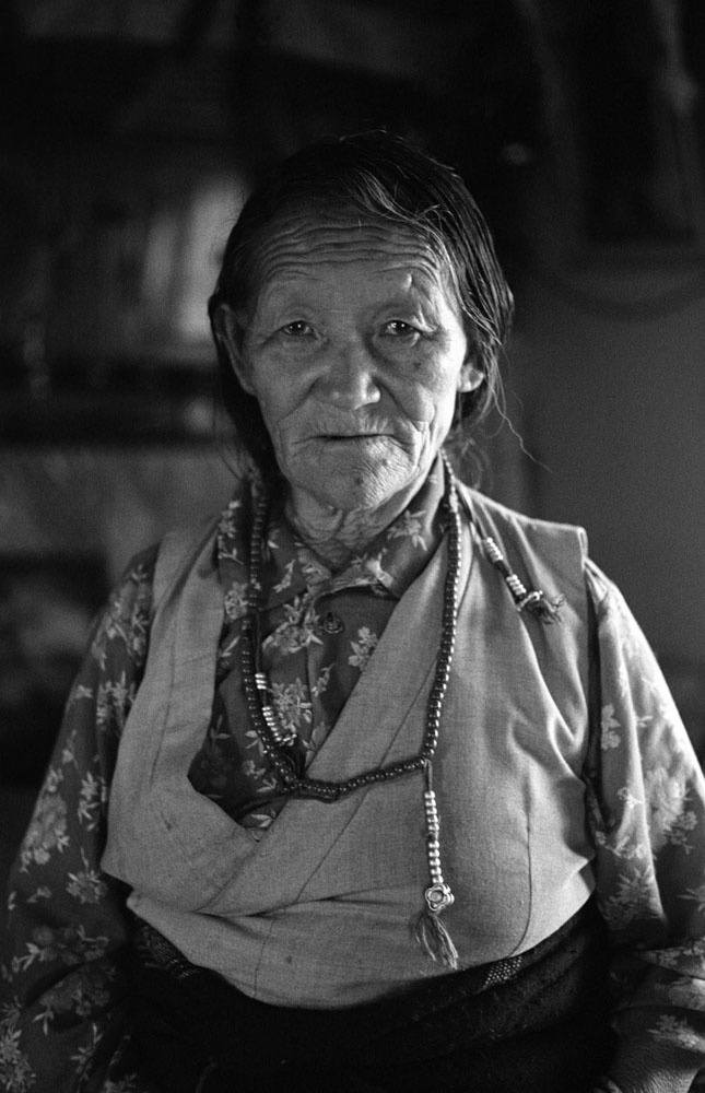 An old exiled Tibetan woman at her house in Bir, India.