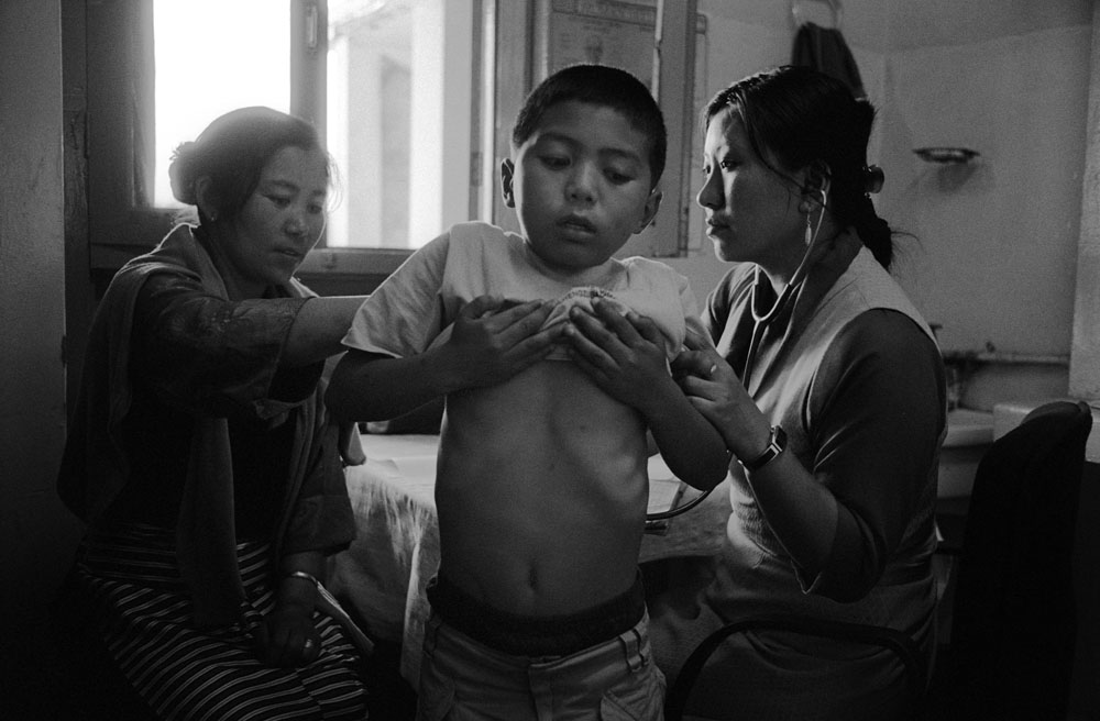 An exiled Tibetan family in a Tibetan clinic in Dharamsala, India.