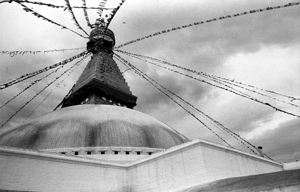 A Tibetan pilgrim prays to the Boudhanath stupa in Kathmandu, Nepal