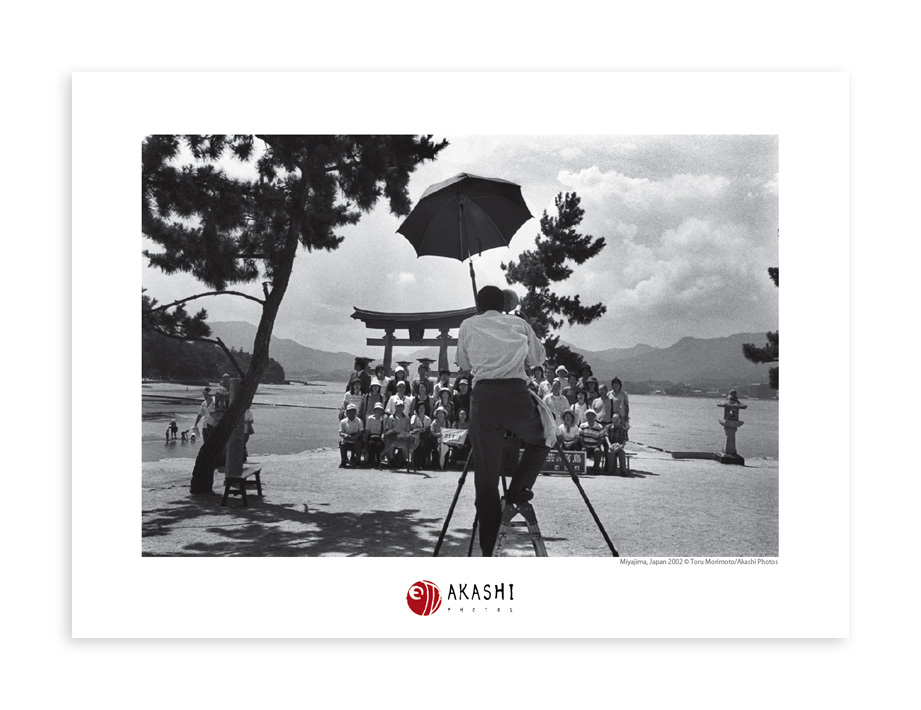 A photographer takes a group picture in Miyajima