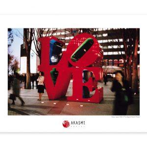 Woman waiting near a Love sculpture in Tokyo