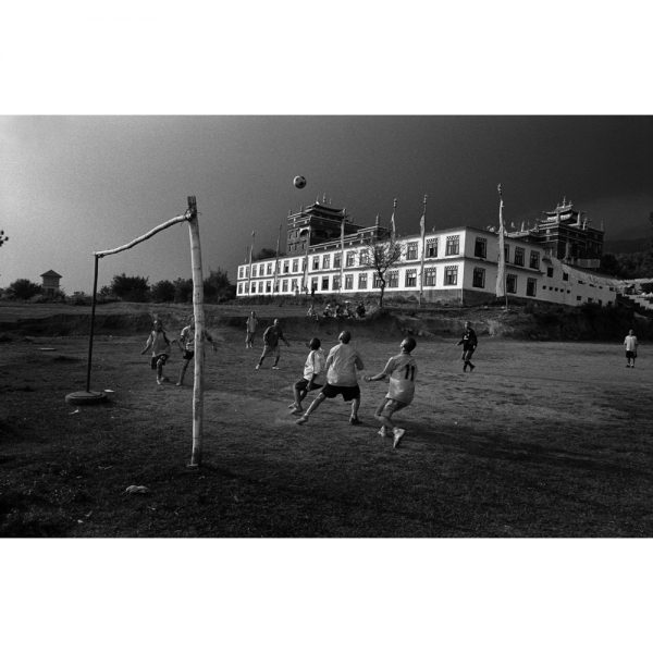 Exiled Tibetan Monks play soccer behind their monastery. Bir, India