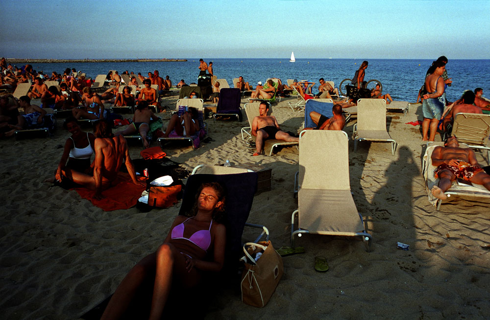 Tourists on the Barceloneta beach in Barcelona, Spain.