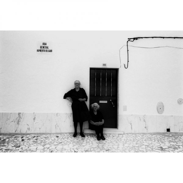 Widows in black clothes in Évora, Portugal