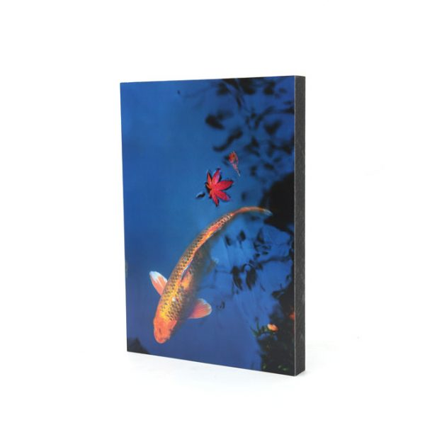 Wood panel on sale with a print of a carp on a blue pond.