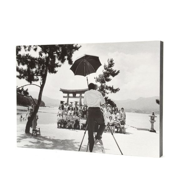 Photographer taking a group picture in Miyajima