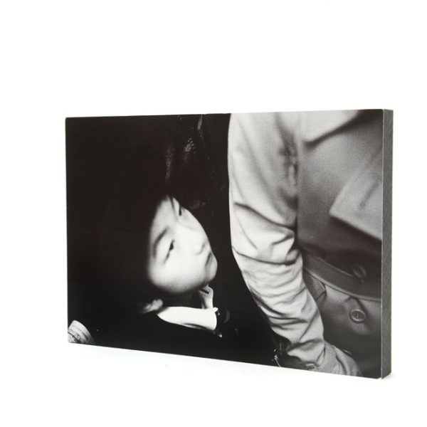 Wood panel photo on sale with a print of Japanese child on the subway by Toru Morimoto